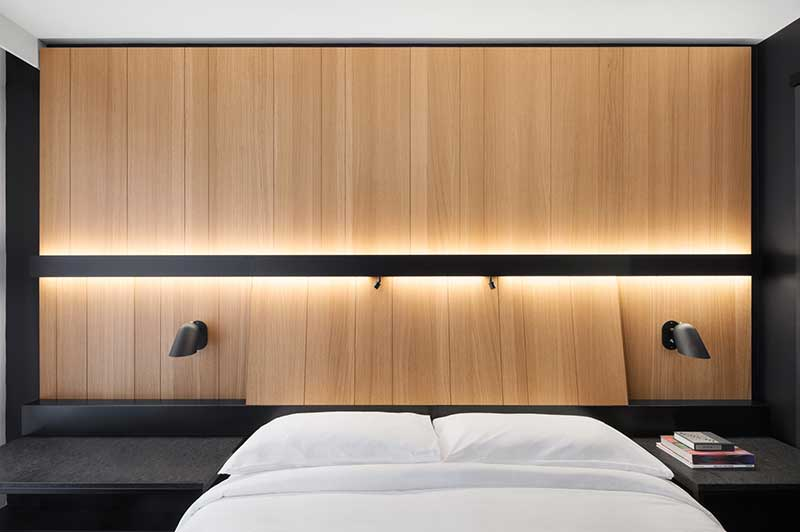 Hotel Room With Black And Wood Decor