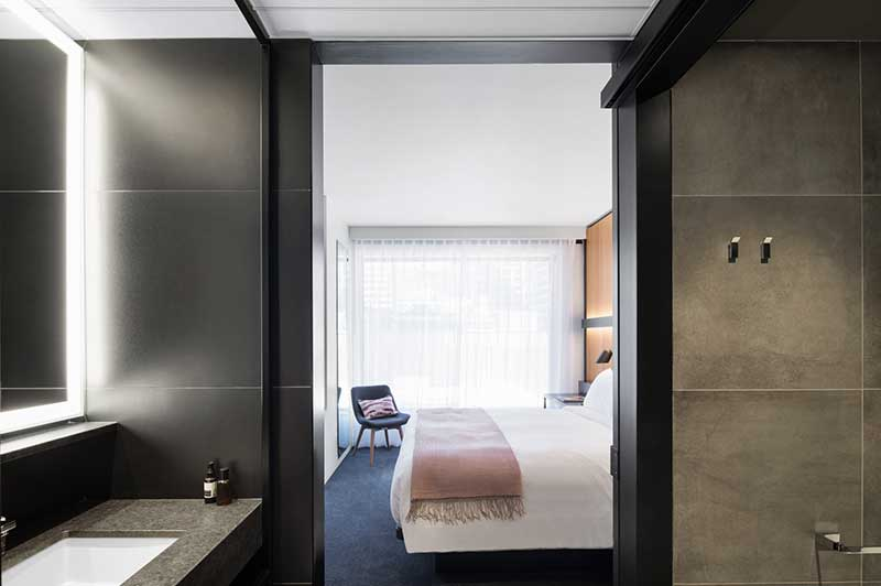 Hotel Room With Grey Accented Bathroom