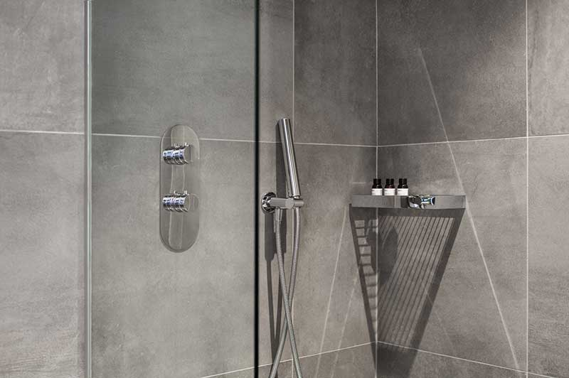 Hotel Suite Shower With Grey Tile